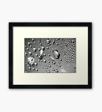 Waterdrops on the bottle. Framed Print
