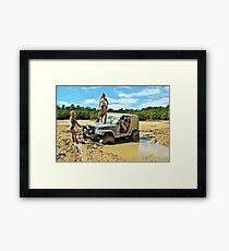 girls in mud Framed Print