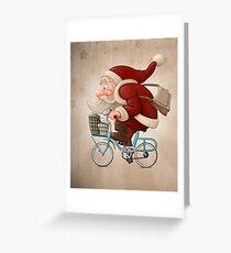 Santa Claus rides a bicycle Greeting Card