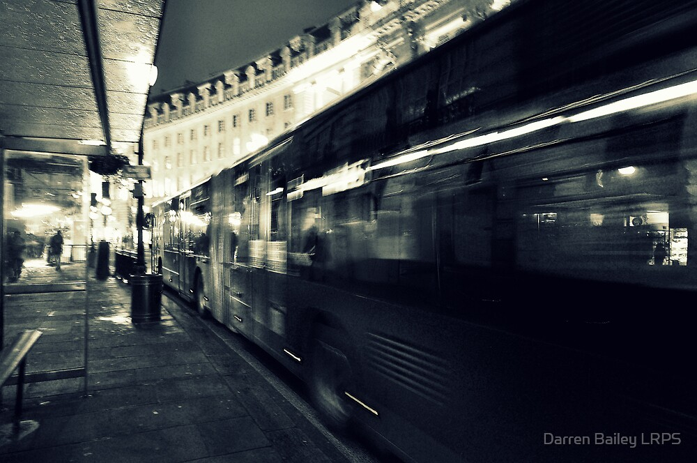 Waiting for the night bus in the dark city street by Darren Bailey LRPS