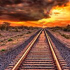 Train track to sunset by Chris Brunton