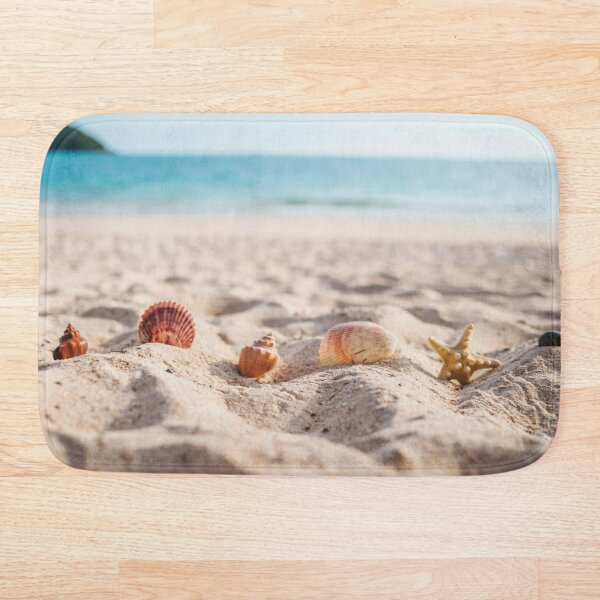 Starfish with seashells in the sand Bath Mat