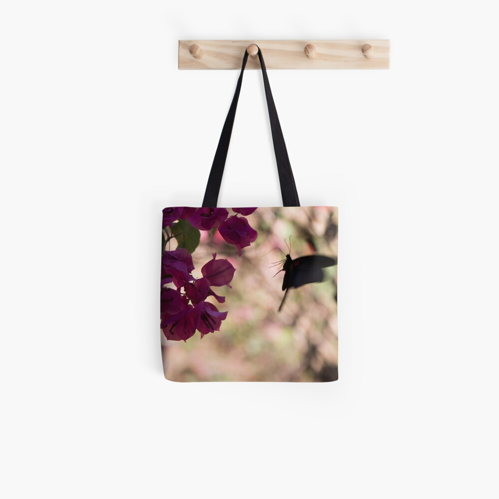 Butterfly flying over Flowers in Koh Kood Tote Bag