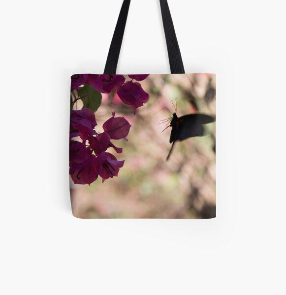 Butterfly flying over Flowers in Koh Kood All Over Print Tote Bag