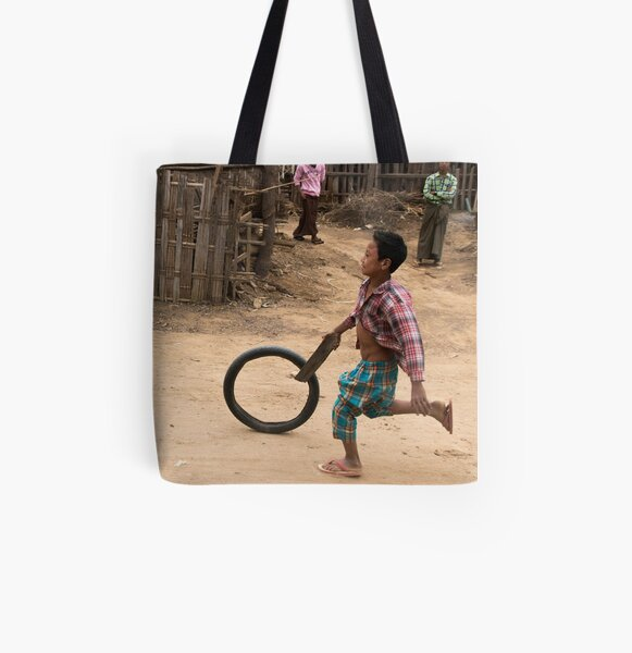 A Child Playing With A Wheel in Myanmar All Over Print Tote Bag