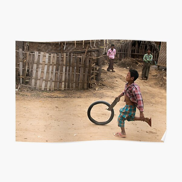 A Child Playing With A Wheel in Myanmar Poster