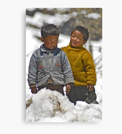 Tibetan brothers up in the Himalayas Canvas Print