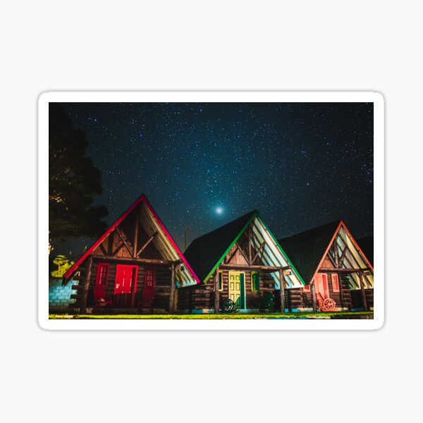 Peaceful landscape of cottages under the starry sky. Sticker