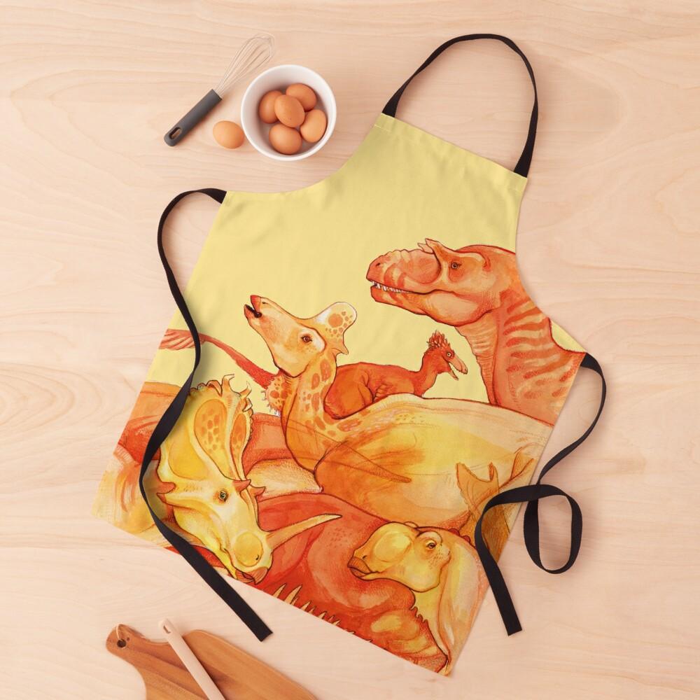 cretaceous congregation - orange & yellow dinosaurs Apron