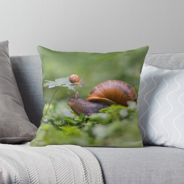 The snail whose kid climbed over everything Throw Pillow