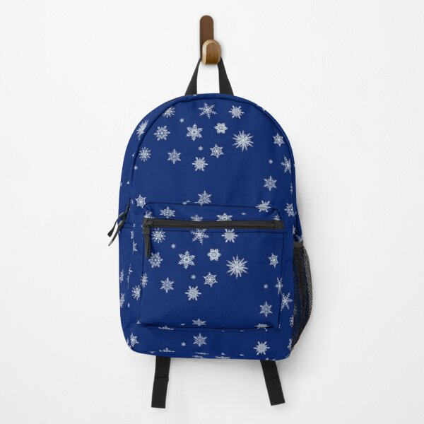 Snowflakes on blue background Backpack
