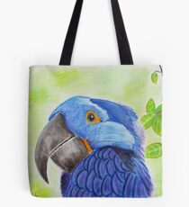 Blue Smiling Parrot on Green leaves Background Tote Bag