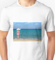 little girl with straw hat looking at sea Unisex T-Shirt