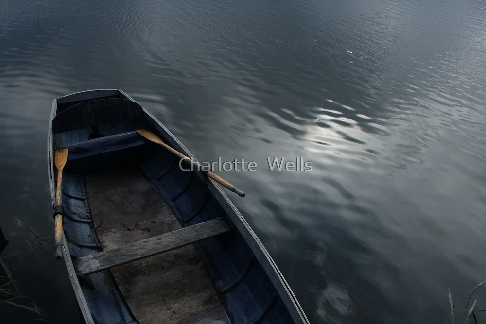 Boat on lake by Charlotte  Wells