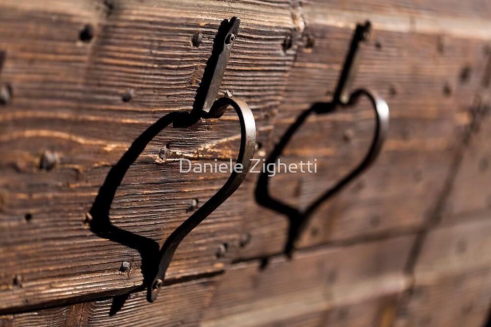 A pair of handles and shadows by Daniele Zighetti