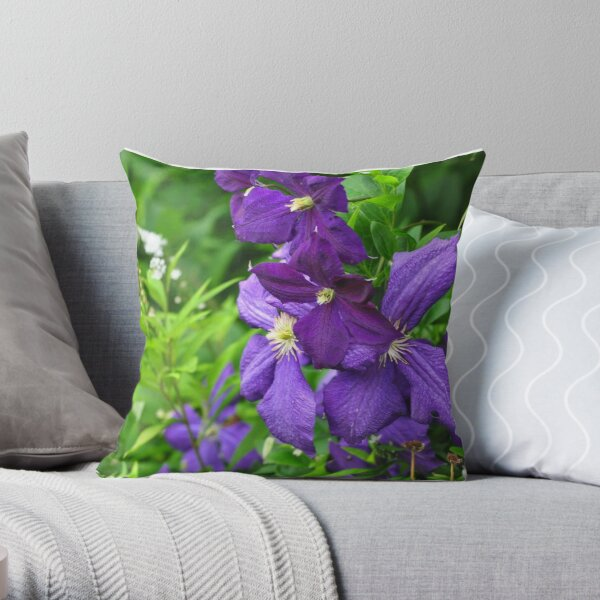 Clematis vines among wildflowers  Throw Pillow