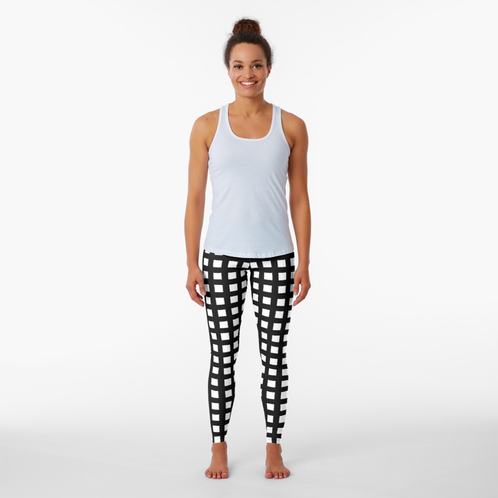 Horizontal and vertical lines. Grid stripes. Geometric pattern. Minimalism. Black and white. Leggings