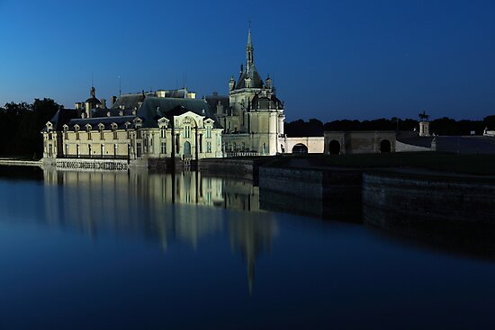 Chantilly, the castle at dusk, Oise, France. by Remy NININ