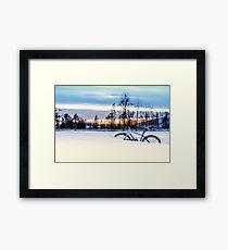 A Snowy Bike Ride Framed Print