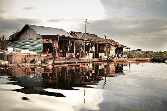 Sunset at Floating Village in Siam Reap by DebWinfield