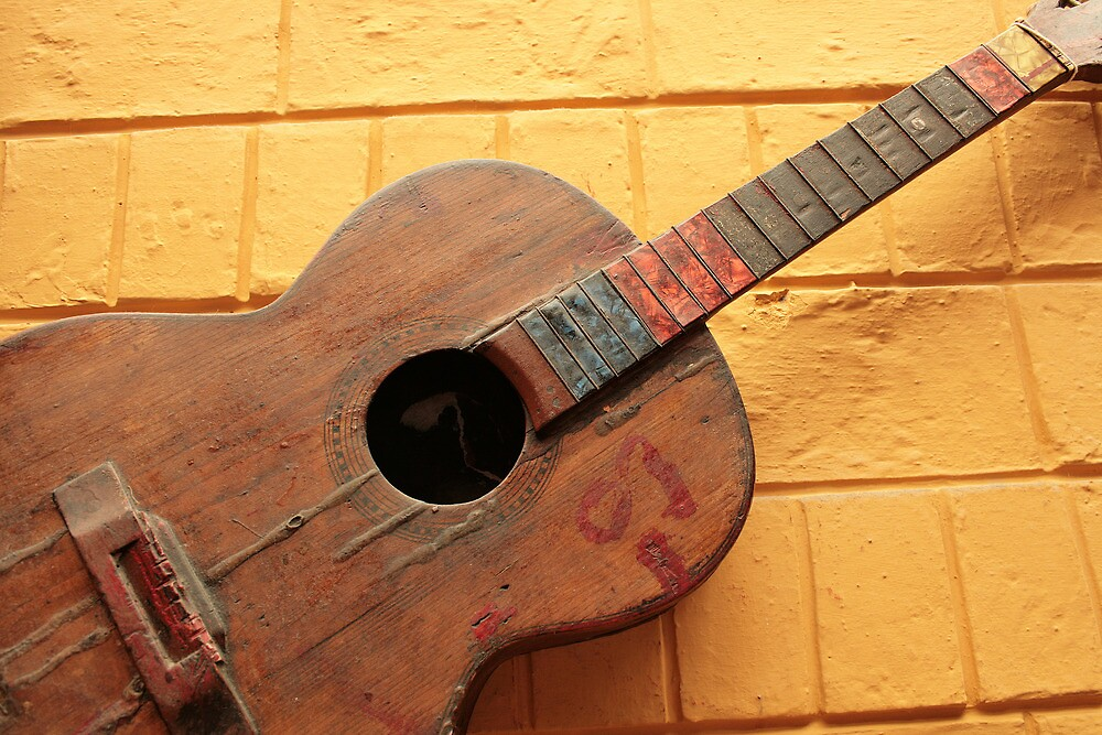 Vintage Guitar on a Wall by rhamm