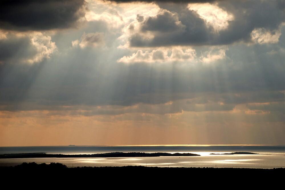 Sunbeams on the islands by Arie Koene