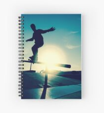 Skateboarder silhouette on a grind Spiral Notebook