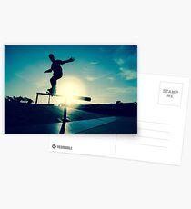 Skateboarder silhouette on a grind Postcards