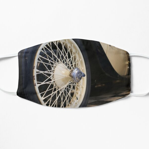 Old spoke wheel of vintage car in cream colour Mask
