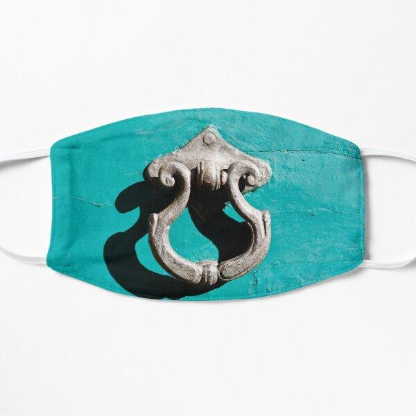 Antique Door Knocker on a Turquoise Painted Door Mask