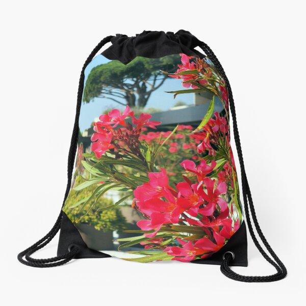 Red oleander blossoms in the mediterranean coastline Drawstring Bag