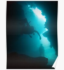 Divers in an underwater cave Poster