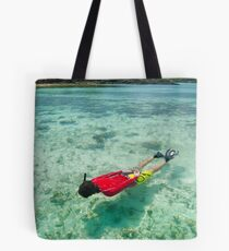 Man snorkeling in shallow water Tote Bag