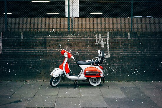Red and white scooter by Michael Reid