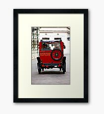 Wheels Akimbo Framed Print