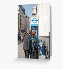 Visitors look at a West End cycle hire map Greeting Card