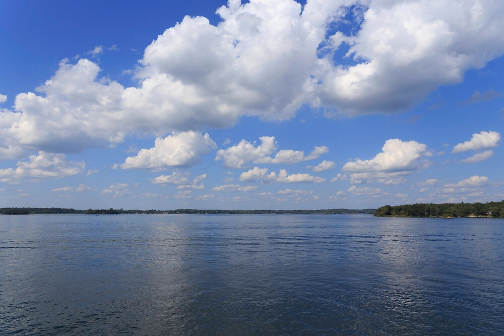 Sky, clouds and river by Josef Pittner