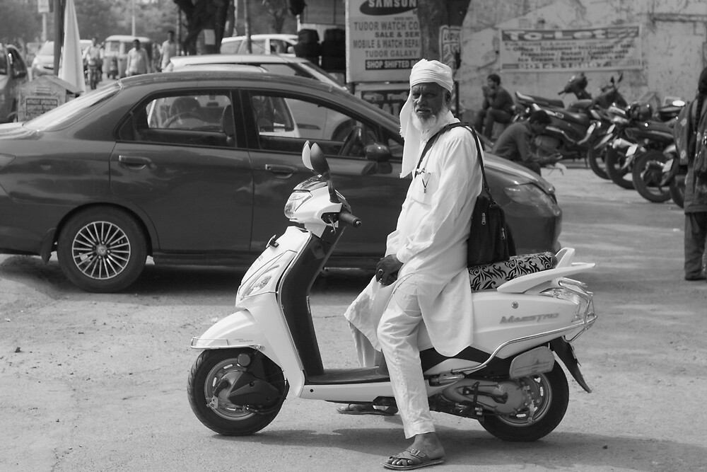 Man on Scooter by Andrew  Makowiecki
