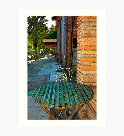 Table On A Sidewalk Art Print