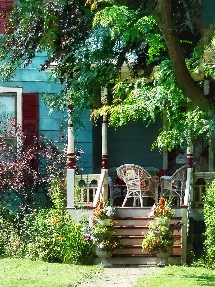 Porch With Flowerpots and Wicker Chairs by Susan Savad
