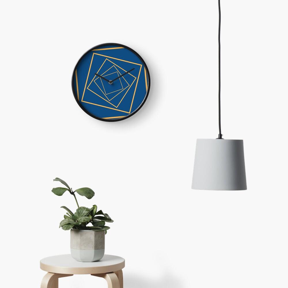Geometric rotating squares navy and mustard Clock