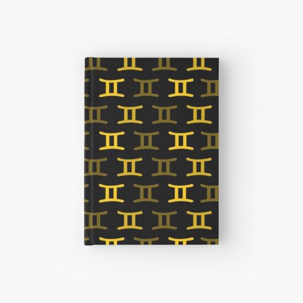 Golden yellow gemini sign, astrology zodiac symbol black background Hardcover Journal