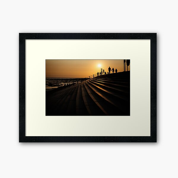 Walking during Sunset Framed Art Print