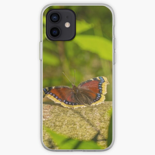 Butterfly in the forest: enchanting Mourning cloak iPhone Soft Case