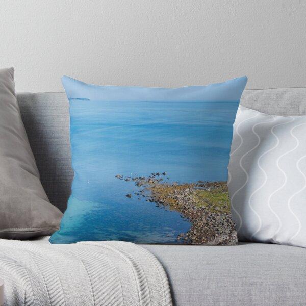 Coastlines frame the blue sea Throw Pillow