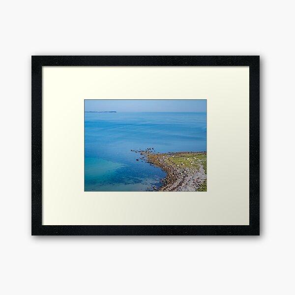 Coastlines frame the blue sea Framed Art Print