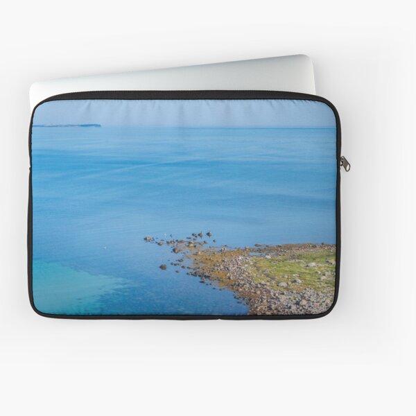 Coastlines frame the blue sea Laptop Sleeve