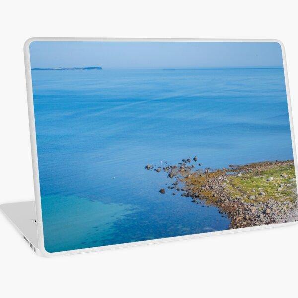 Coastlines frame the blue sea Laptop Skin