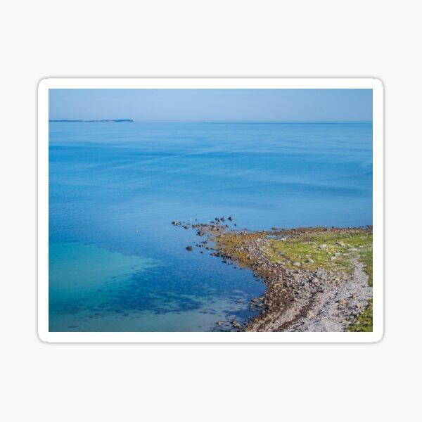 Coastlines frame the blue sea Sticker