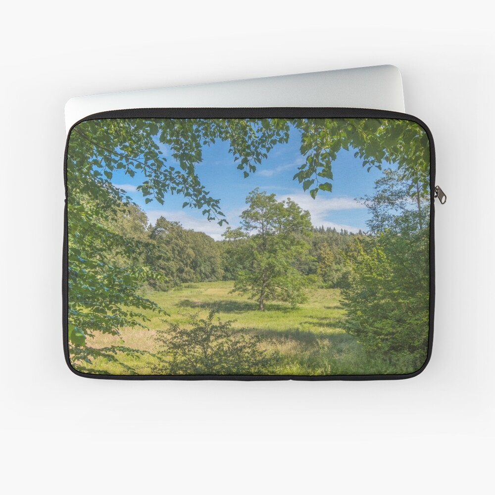 Idyllic clearing in the woods Laptop Sleeve